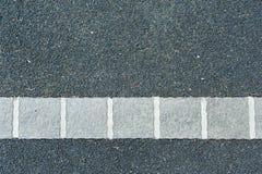 Σκοτεινή άσφαλτος ένα υπόβαθρο Στοκ εικόνα με δικαίωμα ελεύθερης χρήσης