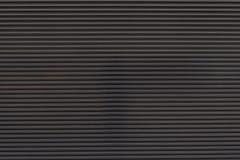 Σκοτεινή γκρίζα πόρτα γκαράζ Στοκ φωτογραφία με δικαίωμα ελεύθερης χρήσης