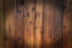 Σκοτεινή ωοειδής μορφή, ξύλινο υπόβαθρο επιτροπής, φυσικό καφετί χρώμα Στοκ Φωτογραφία