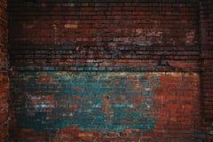Σκοτεινός εγκαταλειμμένος τουβλότοιχος Σύσταση υποβάθρου ενός τούβλου Στοκ Εικόνες