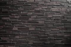 σκοτεινός μαύρος τουβλότοιχος για το σχέδιο και το υπόβαθρο Στοκ εικόνες με δικαίωμα ελεύθερης χρήσης