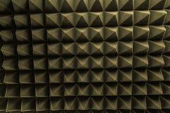 Σκοτεινό γκρίζο τριγωνικό λάστιχο αφρού σύστασης ακουστικό Στοκ Εικόνες