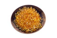 Σκοτεινό πιάτο με τις κίτρινες ηλέκτρινες πέτρες Στοκ φωτογραφία με δικαίωμα ελεύθερης χρήσης