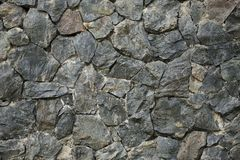 Σκοτεινό σχέδιο υποβάθρου grunge βράχου τοίχων στοκ εικόνες με δικαίωμα ελεύθερης χρήσης