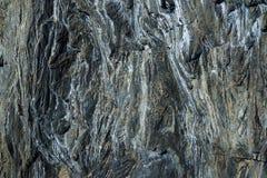 Σκοτεινό υπόβαθρο πετρών με τους ελαφριούς λεκέδες Στοκ Εικόνες