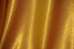Σκοτεινό χρυσό μετάξι υφάσματος Στοκ Φωτογραφία