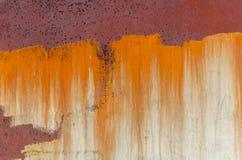 Σκουριά στο μέταλλο, παλαιός φορεμένος τοίχος στοκ εικόνες