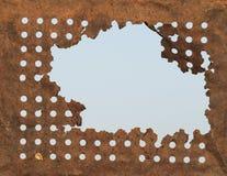 Σκουριασμένες τρύπες κασσίτερου υποβάθρου Στοκ Εικόνα