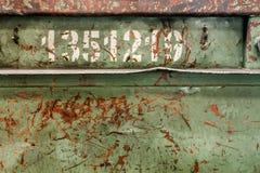 Σκουριασμένο μεταλλικό πιάτο με τους αριθμούς Στοκ φωτογραφία με δικαίωμα ελεύθερης χρήσης