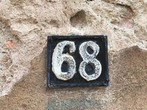 Σκουριασμένο πιάτο των αριθμών οδού Στοκ Φωτογραφίες