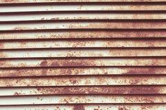 Σκουριασμένο louver υπόβαθρο στοκ εικόνα