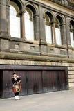 Σκωτσέζικος φορέας Bagpipe Στοκ Φωτογραφίες