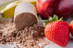 Σκόνη αντικατάστασης γεύματος σοκολάτας με τα φρούτα Στοκ Φωτογραφία