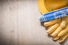 Σκληρά καπέλων μπλε κατασκευαστικά σχέδια γαντιών δέρματος προστατευτικά επάνω Στοκ Εικόνα