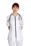 σοβαρές νεολαίες νοσοκόμων γιατρών θηλυκές ιατρικές Στοκ Φωτογραφία