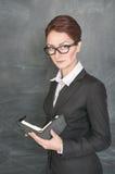 Σοβαρός δάσκαλος με το διοργανωτή Στοκ φωτογραφία με δικαίωμα ελεύθερης χρήσης