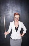 Σοβαρός δάσκαλος στα γυαλιά με το δείκτη Στοκ φωτογραφία με δικαίωμα ελεύθερης χρήσης