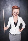 Σοβαρός δάσκαλος στα γυαλιά με το δείκτη Στοκ Εικόνες