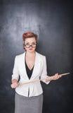 Σοβαρός δάσκαλος στα γυαλιά με το δείκτη Στοκ Φωτογραφία