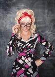 Σοβαρός αναδρομικός δάσκαλος στα γυαλιά που εξετάζει σας Στοκ εικόνες με δικαίωμα ελεύθερης χρήσης