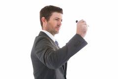 Σοβαρός επιχειρηματίας που κρατά έναν δείκτη και ένα γράψιμο Στοκ φωτογραφίες με δικαίωμα ελεύθερης χρήσης