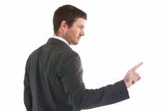 Σοβαρός επιχειρηματίας που στέκεται και που δείχνει το δάχτυλο Στοκ Εικόνα