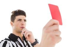 Σοβαρός διαιτητής που παρουσιάζει κόκκινη κάρτα Στοκ Φωτογραφίες
