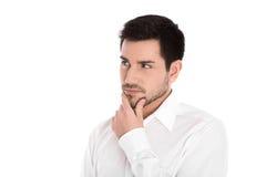 Σοβαρός και σκεπτικός απομονωμένος νέος επιχειρηματίας που κοιτάζει λοξά Στοκ Εικόνα