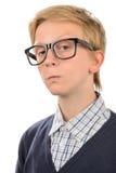 Σοβαρό εφηβικό αγόρι nerd που φορά geek τα γυαλιά Στοκ Εικόνες
