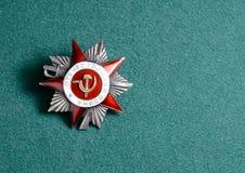 Σοβιετική διαταγή του πατριωτικού πολέμου Στρατιωτικά διακριτικά ένας δεύτερος κόσμος Στοκ Φωτογραφία