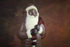 Σοκολάτα Άγιος Βασίλης στο ζωηρόχρωμο κλίμα Στοκ Εικόνες