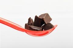 Σοκολάτα στο κόκκινο κουτάλι Στοκ Εικόνα