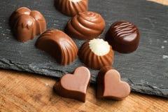 Σοκολάτες με τις διαφορετικές μορφές στοκ εικόνα