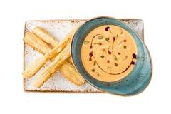 Σούπα κολοκύθας με τα ραβδιά ψωμιού Στοκ Φωτογραφία