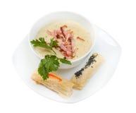 Σούπα κρέμας. ζαμπόν και κουλούρι στοκ φωτογραφίες