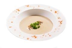 Σούπα κρέμας με popcorn, arugula στο λευκό Στοκ Φωτογραφίες