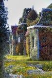 Σπίτια κήπων θαύματος του Ντουμπάι που καλύπτονται με τα διαφορετικά λουλούδια Στοκ φωτογραφίες με δικαίωμα ελεύθερης χρήσης
