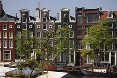 Σπίτια καναλιών στο Άμστερνταμ Στοκ Φωτογραφία