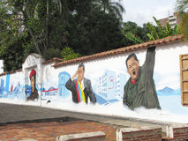 Σπίτια με τα πρώην της Βενεζουέλας γκράφιτι Προέδρου Hugo Chavez Στοκ φωτογραφίες με δικαίωμα ελεύθερης χρήσης