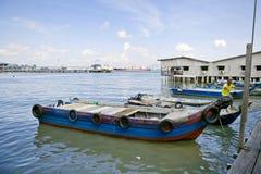 Σπίτια ξυλοποδάρων κληρονομιάς του λιμενοβραχίονα γενιάς μασήματος, πόλη του George, Penang, Μαλαισία Στοκ Φωτογραφία