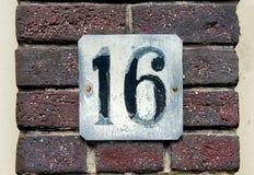 Σπίτι αριθμός δέκα έξι 16 Στοκ Εικόνα