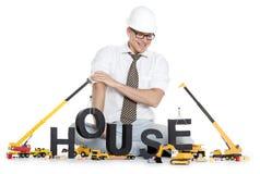 Σπίτι κάτω από την κατασκευή: Σπίτι οικοδόμησης μηχανικών Στοκ φωτογραφία με δικαίωμα ελεύθερης χρήσης