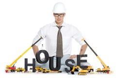 Σπίτι κάτω από την κατασκευή: Σπίτι οικοδόμησης μηχανικών Στοκ Φωτογραφίες