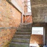 Σπίτι κατασκευής κατοικημένου με τον τοίχο τούβλων Στοκ Εικόνα