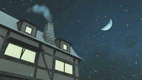 Σπίτι με την καπνίζοντας καπνοδόχο στη νύχτα χιονοπτώσεων
