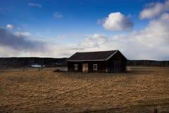 Σπίτι σε έναν τομέα Στοκ Εικόνες