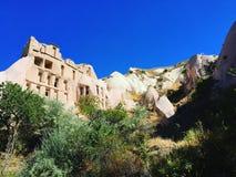 Σπίτι σπηλιών στην κοιλάδα περιστεριών Uçhisar σε Goreme, Τουρκία Στοκ Εικόνα