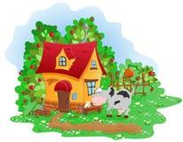 Σπίτι στο χωριό και μια αγελάδα ελεύθερη απεικόνιση δικαιώματος
