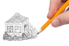 σπίτι χεριών σχεδίων Στοκ Φωτογραφία