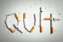 Σπασμένα τσιγάρα που τακτοποιούνται ως λέξη που εγκαταλείπεται Στοκ Εικόνες